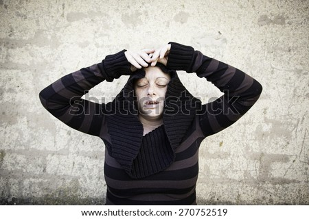 Rare girl covered with striped sweater - stock photo