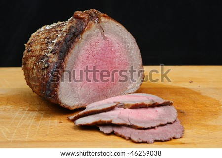 Rare roast beef joint - stock photo