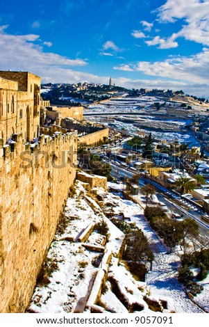 Rare snow on Jerusalem's ancient walls - stock photo