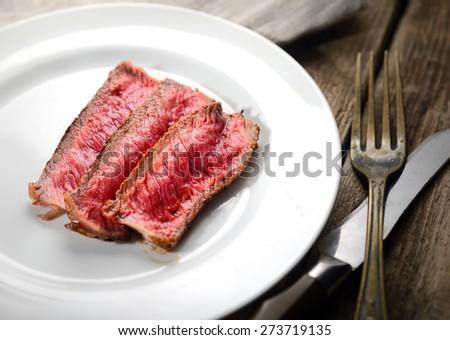 Rare steak  - stock photo