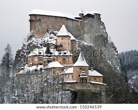 Rare view of famous Orava Castle in winter after strong snow storm. This castle is situated on a high rock above the river Orava, located in Oravsky Podzamok town, Orava region, northern Slovakia. - stock photo