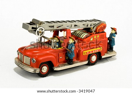 rare vintage fire truck toy isolated on white - stock photo