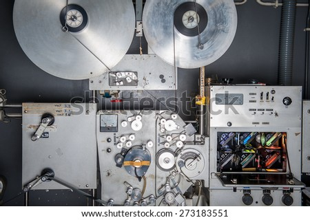 Rare vintage industrial cinema 35 mm movie printer with film loaded, analog optical process with rgb lamps in post production factory - stock photo