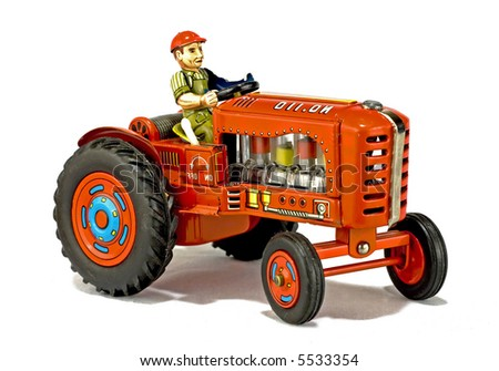 rare vintage red tractor toy isolated on white - stock photo