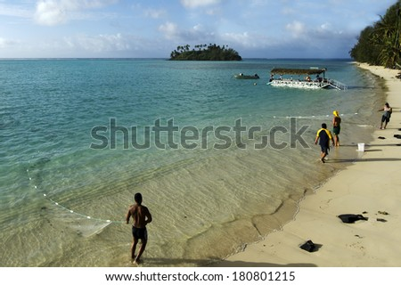 RAROTONGA,COK - SEP17 2013:Fishermen in Muri Beach.Cook Islands may become one of the world's richest countries within a decade by collecting minerals from the sea floor that worth billions of dollars
