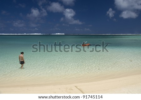 RAROTONGA, COOK ISLANDS,OCTOBER 14 : Tourists relax in the warm lagoon waters of Rarotonga, a popular visitor destination in the South Pacific. October 14, 2008 in Rarotonga, Cook Islands. - stock photo
