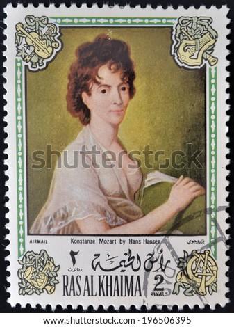RAS AL KHAIMA - CIRCA 1972: A stamp printed in Ras Al Khaima shows painting of Hans Hansen - Portrait of the composer's wife, Konstanze Mozart, circa 1972  - stock photo