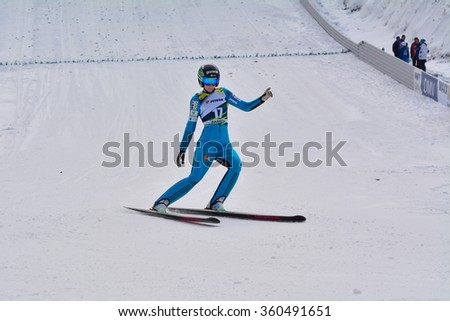 Rasnov, Romania - February 7: Unknown ski jumper competes in the FIS Ski Jumping World Cup Ladies on February 7, 2015 in Rasnov, Romania