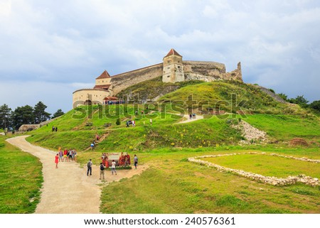 Rasnov, Romania - July 16, 2014: Tourists visit the medieval castle in Rasnov. Fortress was built between 1211 and 1225