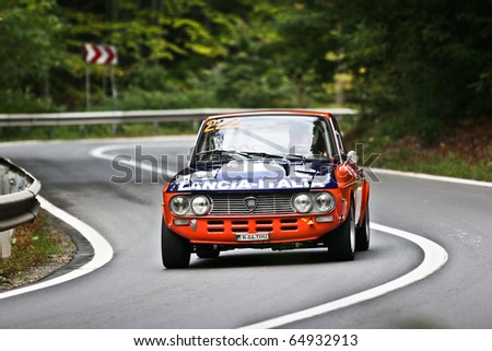 RASNOV, ROMANIA - OCT. 1:  Calin Popescu Tariceanu drives a Lancia Fluvia car during Rally of Romania 2010 championship on October 1, 2010 in Rasnov, Romania.