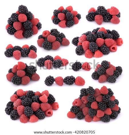 Raspberries and blackberries on white background - stock photo