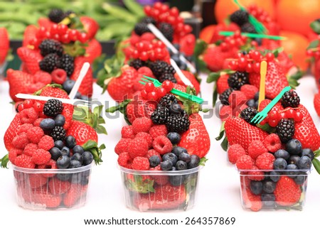 raspberries, blackberries, strawberries as nice fruit summer background - stock photo