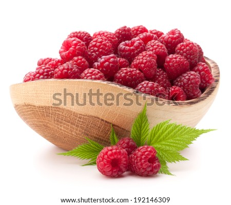raspberries in wooden bowl isolated on white background cutout