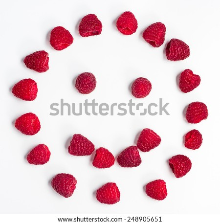Raspberries isolated on white background form a smiley - stock photo