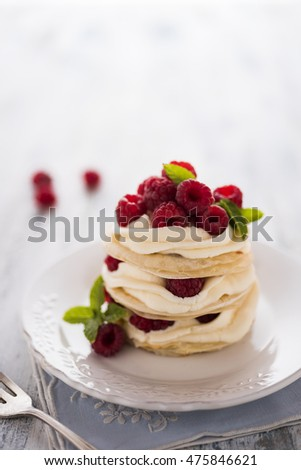 Raspberries mille feuille with fresh mint leafs