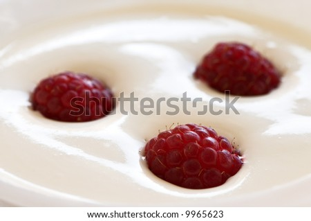Raspberries on cream - stock photo