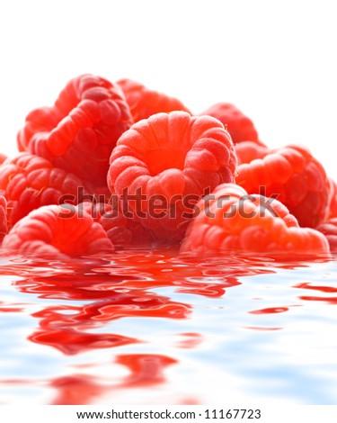 Raspberries reflected in water - stock photo