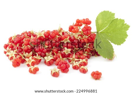 raspberries' ripe fruit and leaf on white background