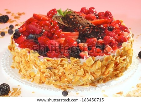 Raspberry and blackberry cake w cream ground nuts and mint - stock photo
