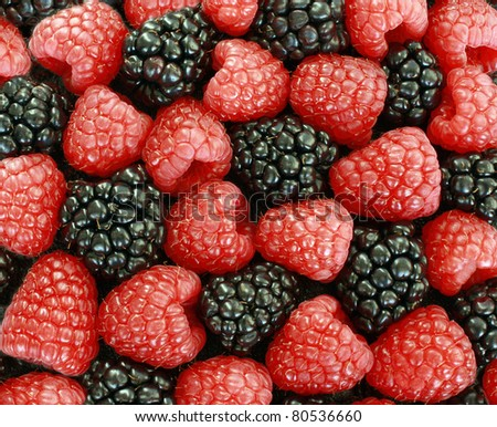 Raspberry and blackberry patterned background - stock photo