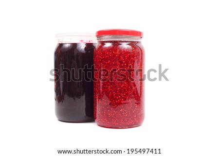 raspberry and currant jam in jar isolated
