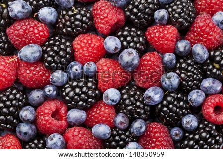 Raspberry, blackberry and blueberry background - stock photo