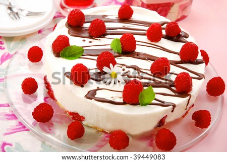 raspberry cake decorated with fresh fruits and melissa leaves