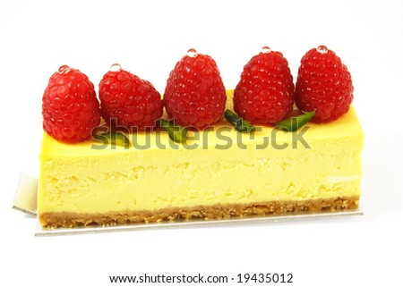 raspberry cheesecake on white colored background - stock photo