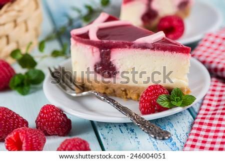 Raspberry cheesecake with fresh fruits - stock photo