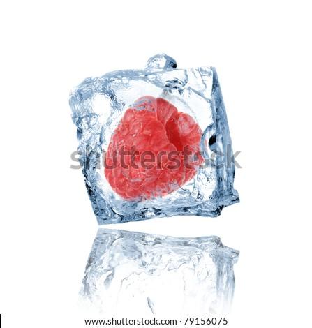 Raspberry frozen in ice cube - stock photo