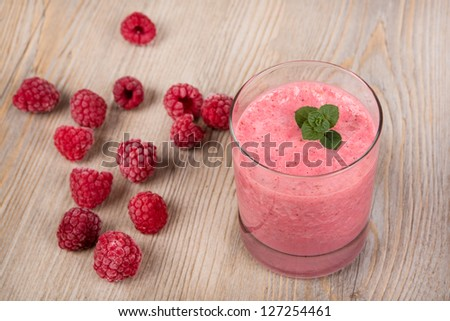 Raspberry healthy smoothie drink. On wooden background. - stock photo