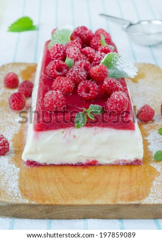 Raspberry ice-cream dessert; semifredo decorated with mint on wood board - stock photo