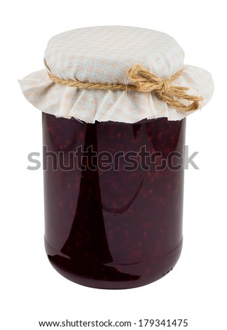 Raspberry jam a popular fruit conserve in a jar with traditional cloth lid isolated against a white background - stock photo