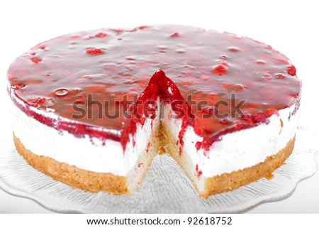 Raspberry layer cake serves on glass plate - stock photo