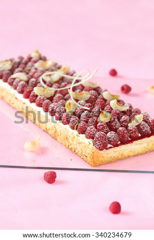 Raspberry Lychee Lime Pavlova Cake on a light pink background. - stock photo