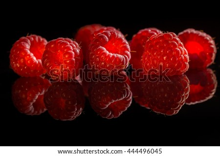 Raspberry on black background