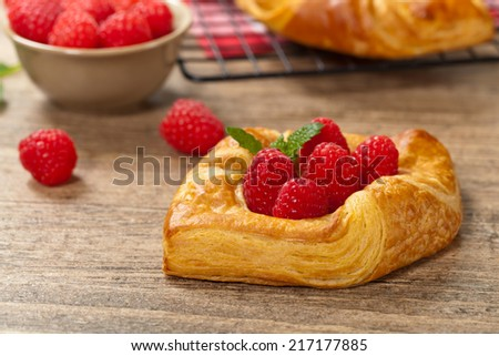 Raspberry pastries. Selective focus. - stock photo