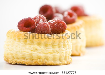 raspberry pastry cream and decorated with lemon parsley isolated - stock photo