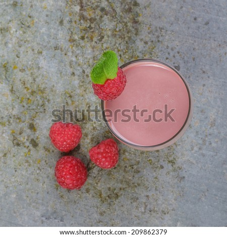 Raspberry Smoothie in a Glass on a Slate Board  - stock photo