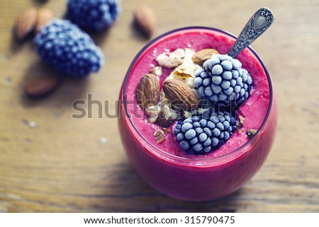 Raspberry smoothie with ice cream and blackberries