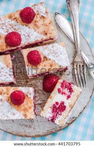 raspberry summer cake with fresh fruits, sliced. Top view from above. - stock photo