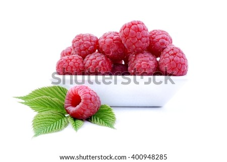 Raspberry. Sweet raspberry isolated on white background. Ripe red raspberry on white. Raspberry with green leaves. Raspberry in white bowl. Delicious fresh raspberry.  - stock photo
