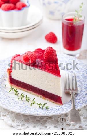 Raspberry tart, mousse cake, cheesecake with fresh raspberries on a white wooden background - stock photo