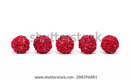 Raspberry truffles in a row, isolated on white - stock photo