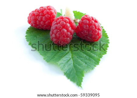 Raspberry with leaves isolated on white