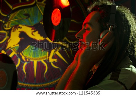 Rastaman listen the playlist before the concert - stock photo
