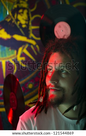 Rastaman sitting on the stage before the concert