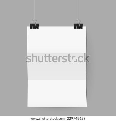 Raster version. White sheet of paper folded in three. The paper hangs on black binder clips.