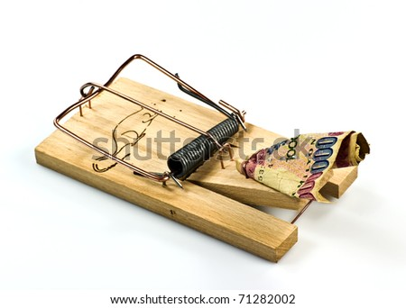 Rat trap with banknote on white background