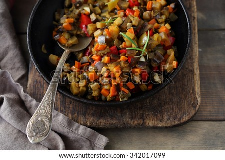 ratatouille made of eggplants, squash, tomatoes and onions, top view - stock photo